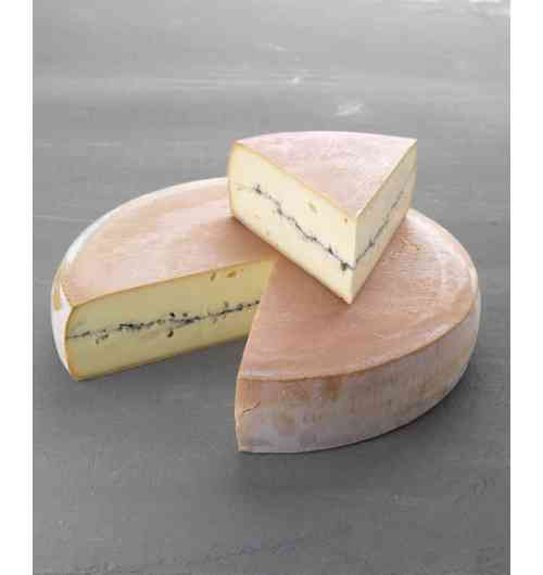 Morbier - Cheese from the Jura Massif, Morbier is made from raw Montbéliarde and Simmental cow milk fed on grass and hay. Le Morbier is distinguished by its ashy line