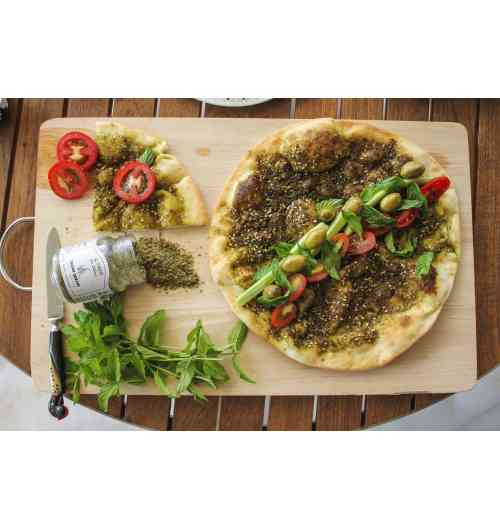 Zaatar Qawzah - 70g - Serve with a little olive oil and bread. Pairs well with pizzas, meats, salads and fresh and white cheeses. Ingredients : Roasted sesame, oregano, sumac and salt.